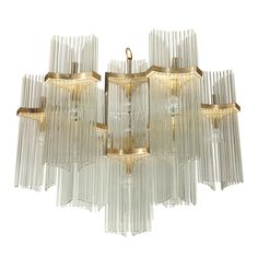 A 1965 vintage Italian brass and glass rod chandelier by Gaetano Sciolari. Has 21 light bulb sockets. Height from the the bottom to the ring above the glass rods is 26 inches. Chandelier Pendant Lights, Modern Chandelier, Pendant Lamp, Ceiling Lamp, Ceiling Lights, Ceiling Installation, Antique Lighting, Decorative Lighting, Modern Glass