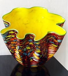 Carnival Macchia, Dale Chihuly. It was the spirit of experimentation that led Dale Chihuly to work with all 300 colors available in his hotshop to create the Macchia series. For this series, he created a unique process that allowed him to contrast the interior and exterior colors without blending them together—a predominant characteristic of this vibrant series.