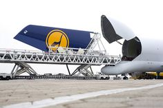Beluga unloading A380 DLH Vertical Tailplane