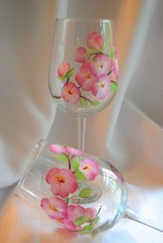 Hand painted wine glasses with pink cherry blossoms! Makes you feel like spring! This set is for two wine glasses, but a set of four is available upon