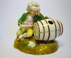 Staffordshire 'Tipsy Lawyer' porcelain figure by Dudson. Variations on the tipsy lawyer theme are quite common at this period.