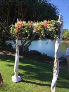 Mondo Florist created this arbour absolutely stunning.  Novotel Twin Waters Resort with Suzanne Riley Marriage Celebrant