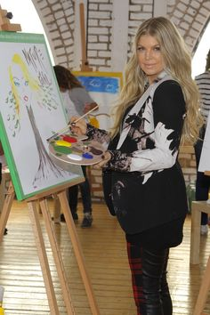 A self-portrait, perhaps? #Fergie puts her painting skills to the test at Unilever's Universal Children's Day event on Nov. 20 in Glendale, Calif.