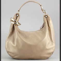 "Jimmy Choo Metallic ""Solar"" Hobo Bag - Sand This is a gently used bag. Small mark pictured near logo. Bangle detaches and is wearable as bracelet. Best offers will be considered. Metallic pebbled deerskin. Golden hardware. Padded shoulder strap has 11"" drop. Linked bangle strap detail; 3"" interior diameter. Dipped zip top fits snugly under arm. Suede lining; open pocket and zip pocket. 12""H x 18""W x 6""D. Bag weight: 2lbs. ""Solar"" is made in Italy Jimmy Choo Bags Hobos"