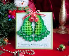 This project gives a funny new meaning to a holiday favorite! The Mistle-Toes ornament is detachable from the card so the recipient can use it as a decoration. A fun project for all ages!