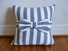 DIY bow pillow. This one is my favorite of all the bow pillow.s I love stripes (;