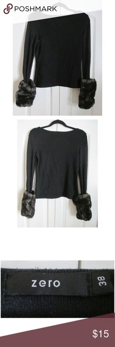 """Cute boatneck sweater with faux-fur cuffs Such a great piece for cooler days! One of my all-time favorites. :-) Timeless black sweater with bateau neckline and the most beautiful attached faux-fur cuffs. Cotton knit, by popular European brand ZERO. Euro size 38, which is equivalent to a US 6-8. Appr 17.5"""" across bust, 15"""" waist, 20"""" long, 25"""" sleeves. In good pre-loved condition with minor pilling. Nothing too severe, though, and this lovely piece still has a tons of life left. Ships from a…"""
