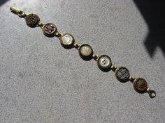 antique button bracelet...3 in center r mops