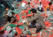 E-waste piled so high in Guiyu, China, the workers are literally swimming through the garbage!