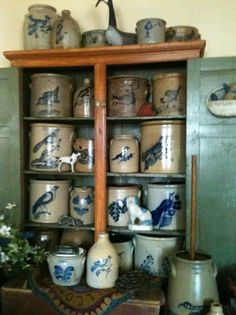 Great collection of Cobalt Stoneware Crocks and Spaniel in a wood step-back cupboard.
