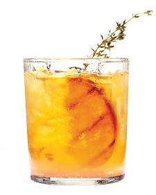 Grilled-Peach Old Fashioned 2 ripe yellow peaches 2 tablespoons sugar 6 sprigs thyme, plus more for garnish 4 dashes of bitters 2 tablespoons fresh lime juice 6 ounces bourbon