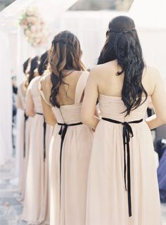 blush colored #bridesmaid dresses tied up with a black bow Photography By / carolinetran.net