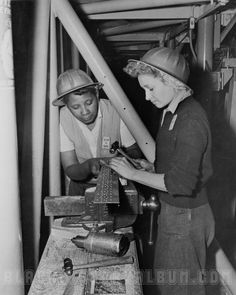 Young African American women employed by the Douglas Aircraft Company in Long Beach, California, 1938. Two of thousands of African Americans who moved to California and through the West Coast during World War II to find work in arms and munitions plants.
