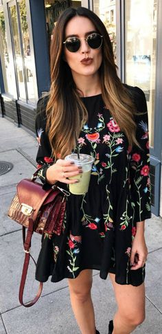 little black dress + extra dose of femininity + all-over embroidered floral motifs + Brittany Xavier + pair of black ankle boots + burgundy croc patterned hand back + Aviator glasses + element of cool + On cooler days add tights + simple oversized scarf + maxi coat + suede leather jacket + look feminine and fresh.