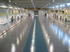 Stonhard's Stonclad GS seamless floor in a helicopter hangar. This troweled, epoxy mortar system provides superior impact and abrasion resistance in a heavy-duty environment.