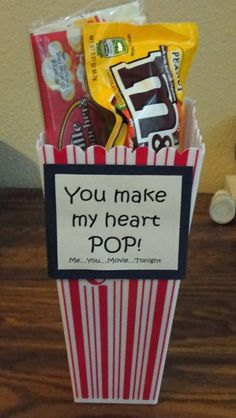 Movie night on Valentine's Day....**UPDATE** Made this for my husband for Valentine's Day. Filled the bottom of popcorn box full of mini sized candy & put a movie & popcorn in the top. Too Cute!