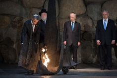 President Obama rekindles the eternal flame in the Hall of Remembrance during his visit to the Yad Vashem Holocaust Museum in Jerusalem, March 22, 2013.