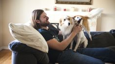 Chris Stephens, 28, who has been battling depression all of his life, plays with his dogs at home in Concord, Calif., on Friday. After a dos...