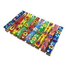 Hand painted clothespins. Let the kids paint them, slap a magnet on the back, and use them as fridge magnets to hold their artwork!!