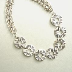 Antique Silver Metal Necklace with Seven Discs | wowthankyou.co.uk £27.00