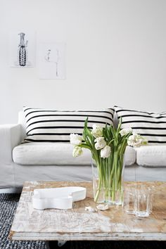 Striped cushions are a great living room update. Pair with flowers and distressed furniture for a Parisian feel. Living Room Inspiration, Interior Design Inspiration, Home Decor Inspiration, Interior Ideas, Home Living Room, Living Room Decor, Living Spaces, Striped Cushions, Striped Sofa