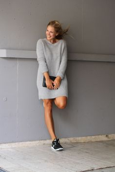 Grey oversized slouchy sweater dress, black leather clutch, nike freen run sneakers
