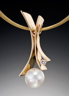 Fiore del Mare with South Sea Pearl | Adam Neeley Fine Art Jewelry | This unique pendant design features a white South Sea Pearl with a 0.25 carat VS G accent diamond in 14kt yellow gold.