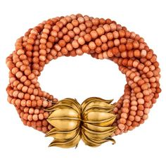 beaded orange coral bracelet with a great gold clasp. Are those lotuses?