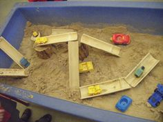 Bamboo pieces in the sand with vehicles