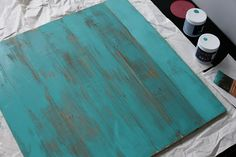 DIY distressed wood - you/we could make very simple and bold art that is just, let's say for now, 4 squares of color on a clean white wall that pick up colors from the rug - sublime-decor.com