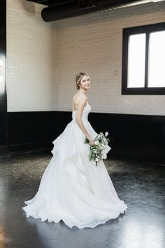 Get ready to feel like a princess in this Zac Posen tiered skirt ballgown  from David s Bridal! Photo by Matthew Ree Photography for Style Me Pretty 8898caa7be85