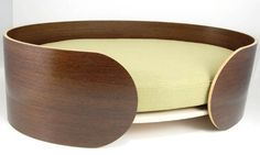 The Ellipse pet beds elegant design and simple form will compliment any room. It features an elliptical form in bent ply and wrapped in a choice of veneers. The cushion is usually covered in an outdoor grade upholstery fabric, although this can be customized. Designed and Hand made in Canada.  Please contact me with any questions about having this piece crafted for you.