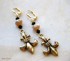 Beige Tan Faceted Crystal Rondelles, Black Crystal Bicones, Gold FleurdeLis Saints Dangle Earrings. $8.00, via Etsy.