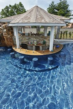 A vacation space in your own backyard ~ pool, waterfall, outdoor kitchen - belly up to the bar!