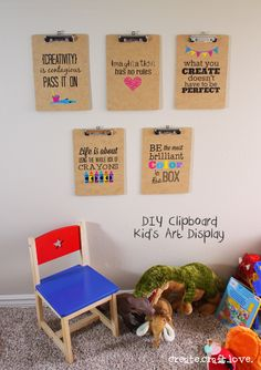 Clipboard Kids Art Display that look great with or without artwork hanging on it! Made with Cricut Explore - via createcraftlove.com