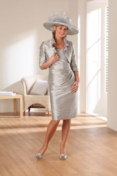 """<div><span style=""""font-style: italic; font-weight: bold;"""">Fitted knee length dress in silver with matching jacket. Elegant yet easy to wear.</span></div> <div></div> <div> <div> <div><strong><em>The colour palette for this fabulous style is simply phenomenal.</em></strong></div> <div><strong><em></em></strong></div> <div><strong><em>We also provide all the matching hats, fascinators, shoes, handbags and jewellery if ..."""