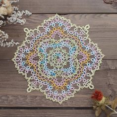 Purple and Teal Square Doily ©Debbie Arnold. I made this in 2012. Free pattern…