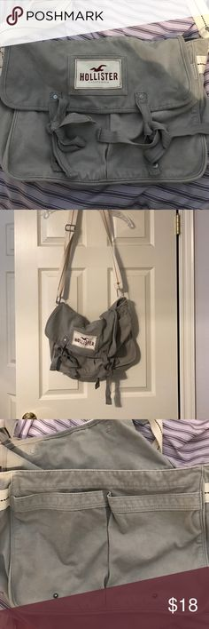 Hollister bag Hollister grey bag! Would be a good traveling bag, or even a school bag. It has two pockets covered by the flap and then on the inner bag there is one pocket. The bag is closed by buttons! There is an adjustable strap as well Hollister Bags Shoulder Bags