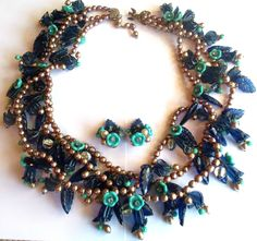 3 strand 4mm beaded necklace, attached flower 'bunch' charms...  Miriam Haskell