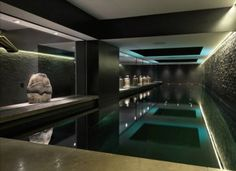 Candy & Candy Interior Design | Indoor pool with green uplighting | The Luxe Lookbook