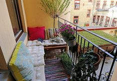 Soften a balcony with cushions to create a comfortable seating area.