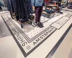 The Aigle K11 art mall is the first 'globetrotter' themed store for the brand and is entirely decorated using ceramic tiles, reminiscent of a Paris metro station, and the famous Charles de Gaulle airport.