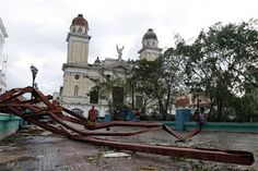 A fallen placard lies on the ground after the passing of Hurricane Sandy in Santiago de Cuba, Cuba, Thursday Oct. 25, 2012. Hurricane Sandy blasted across eastern Cuba on Thursday as a potent Category 2 storm and headed for the Bahamas after causing at least two deaths in the Caribbean. (AP Photo/Franklin Reyes) (