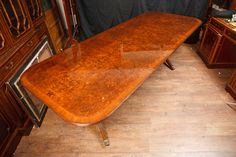 http://canonburyantiques.com/s/dining-tables/regency-dining-tables/1/  Walnut extending Regency pedestal dining table - love the sumputous patina to the walnut on this Regency dining table