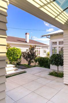 Coloured concrete patio designed by Landsmiths