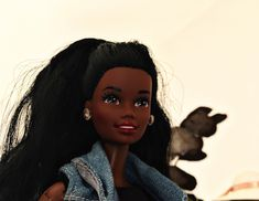 Benetton Christie (the beautifulest black friend of Barbie I know) wears a jeans jacket (FA, 1995) and diamond jewelry from the 80's  I didn't like her original hairstyle so I did a ponytail