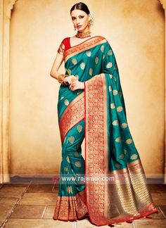 Rama Green Silk Jacquard Saree With Blouse In Matching Red Silk Jacquard. There Is An Option Embroidery Blouse In Red Dupion. Banarsi Saree, Silk Sarees, Indian Dresses, Indian Outfits, Indian Clothes Online, Party Wear Sarees, Green Silk, Saree Blouse Designs, India Fashion