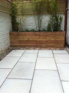 Small courtyard in West Kensington - beautifully constructed small garden but if only they had laid the paving slabs in the opposite direction and used much much smaller sizes it would have made the garden look and feel twice the size.