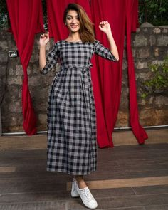 Shop Tie up black checks box pleated dress Indian Fashion Dresses, Frock Fashion, Indian Gowns Dresses, Dress Indian Style, Indian Designer Outfits, Fashion Outfits, Simple Kurta Designs, Kurta Designs Women, Mode Abaya