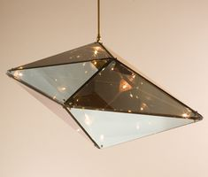 Maxhedron lamp. It's like an infinity mirror for lamps. http://www.becbrittain.com/maxhedron.php